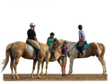 riding instructor in between group of mounted riders