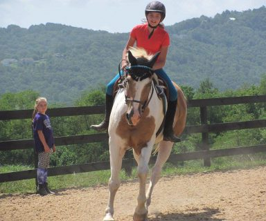 student riding equitation patterns without stirrups