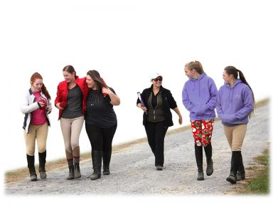 instructor and happy students walking to barn