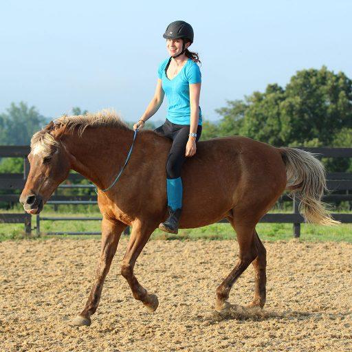 rider cantering bareback and bridleless