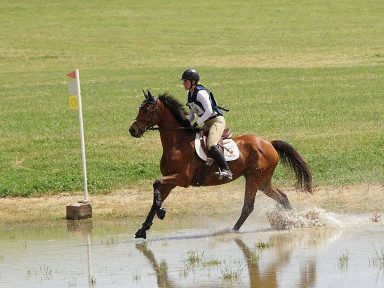 student riding through xcountry water complex at Poplar Place