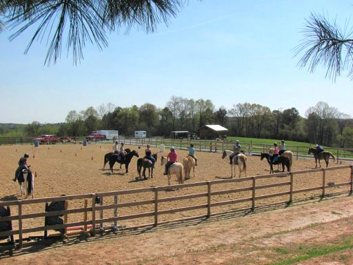 large group of mounted students in arena