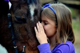 student kissing school pony