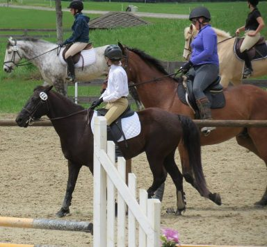 crowded warm-up ring at horse show